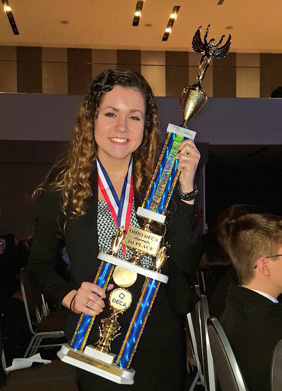 Lexi with first place trophy